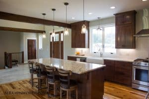 Custom Home timber beam accents kitchen island