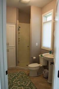 Bathroom pedestal sink walk in shower
